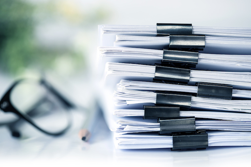 extreamly close up  stacking of office working document with paper clip folder